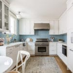 Pure white kitchen and dining area design